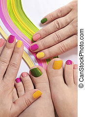 Multicolored bright manicure and pedicure