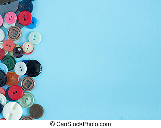 Multicolored buttons on blue background with copy space flat clutch