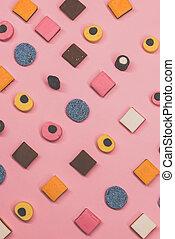 Multicolored candies lies diagonally