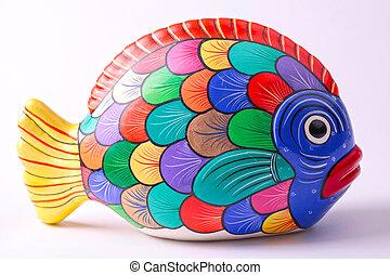 multicolored ceramic fish on white background - multicolored...
