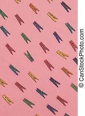 Multicolored clothespins balls lies diagonally in rows.