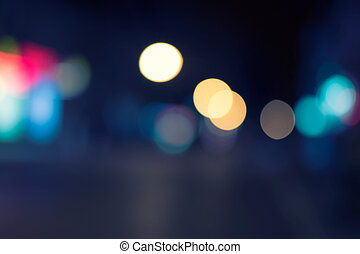 Multicolored defocused lights in the city at night a lot of copyspace