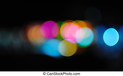 Multicolored defocused lights in the city at night