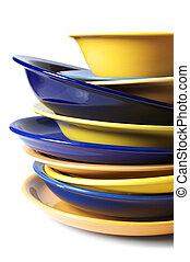 Multicolored dishware - Stack of multicolored ceramic plates...