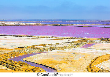 Multicolored fields for evaporation of water in Walvis Bay....