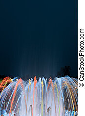 Multicolored fountain at night.