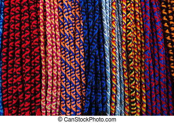Multicolored friendship bracelets background.