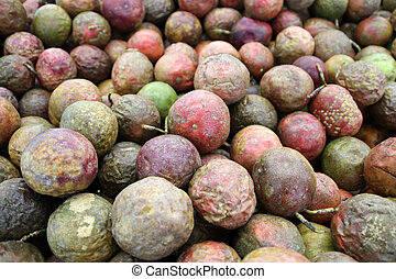 Multicolored fruits of ripe passion fruit sold in the market