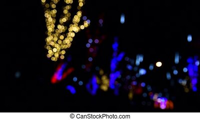 multicolored glowing garlands outside focus on the street