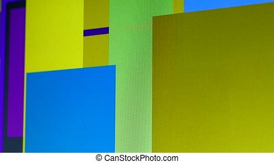 Multicolored graphics of stripes and triangles on a computer monitor