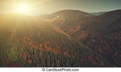Multicolored hill chain peak sun beam aerial view -...