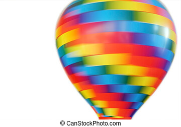 multicolored hot-air balloon toy whirling isolated on white...