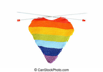 Multicolored knitting in the form of heart on a white background