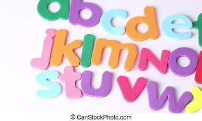 Multicolored letters arranged in three lines, in ...