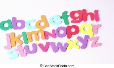Multicolored letters arranged in three lines, one close to...