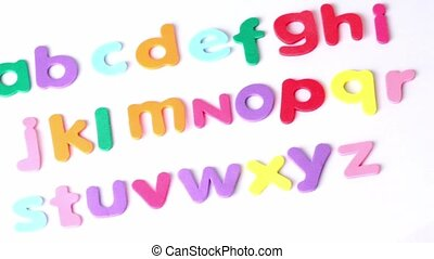 Multicolored letters laid in three rows in alphabetical order