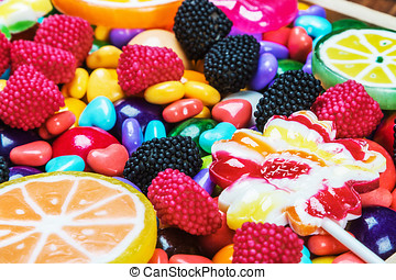 multicolored lollipops, candy and chewing gum