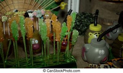 Multicolored lollipops - Orange and green lollipops decorate...