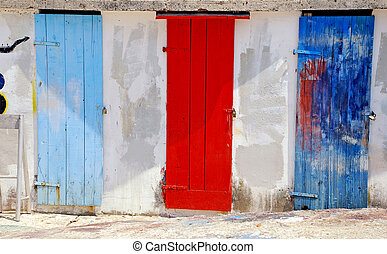 multicolored mediterranean run-down doors - Three ancient...