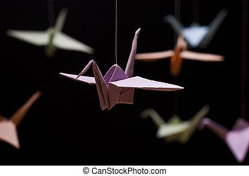 Multicolored Origami Crane on a black background