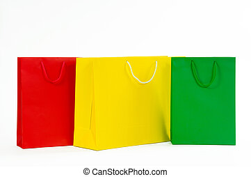 Multicolored paper shopping bag isolated on white