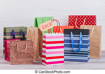 Multicolored paper shopping bags.