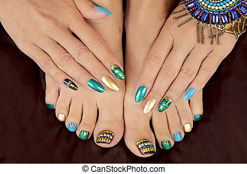 Multicolored pedicure and manicure with rhinestones on oval long female nails