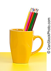 Multicolored pencils in yellow cup.