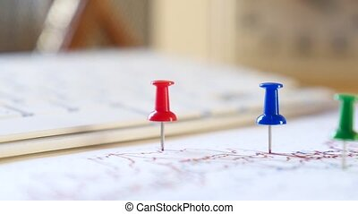 Multicolored pins on the financial report graph. Full HD...