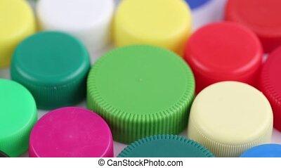 multicolored plastic caps - multi-colored plastic bottle...