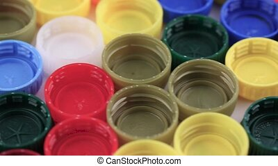 multicolored plastic lid caps - many plastic covers of...