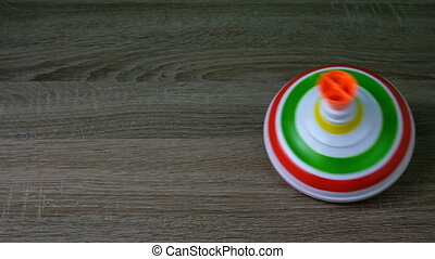 Multicolored plastic spinning top or whirligig top is ...