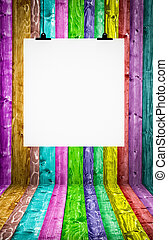 Multicolored room with blank paper hanging on wall