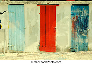 multicolored run-down doors - Three ancient multicolored...