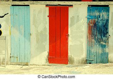 multicolored run-down doors - Three ancient multicolored...