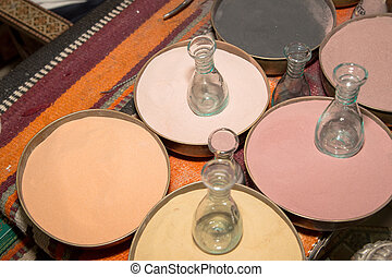 Multicolored sand for traditional souvenirs (bottles with...