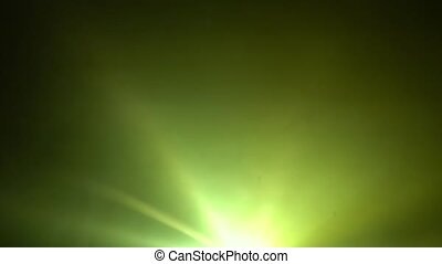 Multicolored searchlights rays on a black background in ...