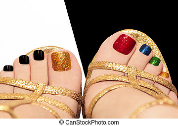 Multicolored shining pedicure on white or black background.