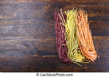 multicolored spaghetti on the table