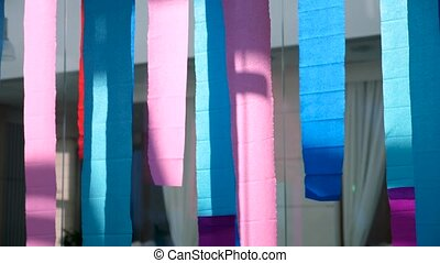 Multicolored stripes hang indoors - Long bright colored...
