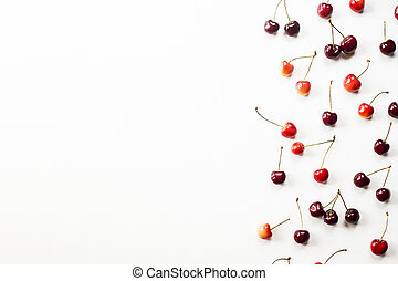 Multicolored sweet cherry on a white background - summer delight