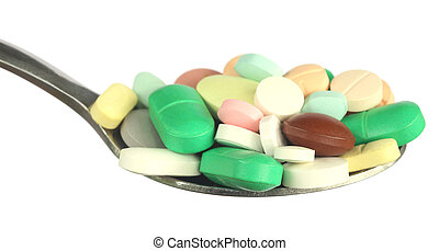 Multicolored tablets on a spoon
