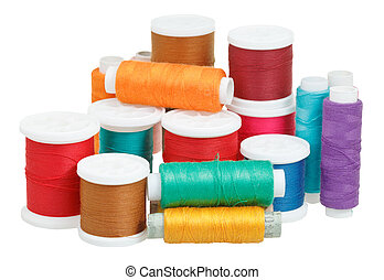 multicolored thread bobbins isolated on white
