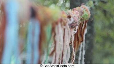 Multicolored thread wool - Woolen thread fluttering in the...