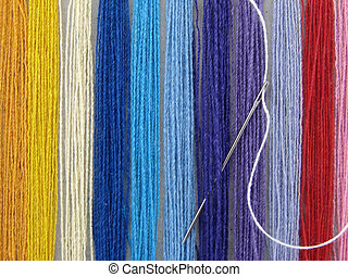 set of the multicolored threads for needlework as a background