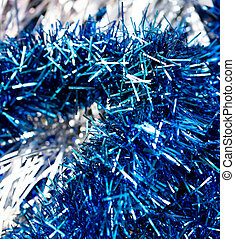 Multicolored tinsel for the New Year as a background