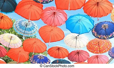 Multicolored umbrellas against the blue sky in Kemer, Turkey
