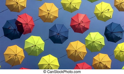 multicolored umbrellas suspended on wires - 4K tracking shot...