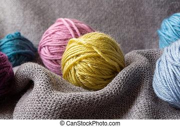 Multicolored wool balls. Knitting hobby. Close up.