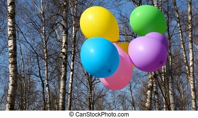 balloons waving by wind - multicoloured balloons waving by...